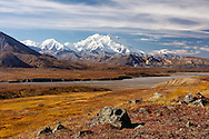 Scenic view of Denali (formerly Mt. McKinley) from Thorofare Pass in Denali National Park in Interior Alaska. Autumn. Afternoon.