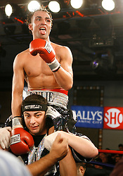 January 5, 2008; Newark, NJ, USA;  IBF Junior Welterweight Champion Paulie Malignaggi celebrates after his 12 round title fight against Herman Ngoudjo at the Grand Ballroom of Bally's Hotel and Casino in Atlantic City, NJ.    Malignaggi retained his title via unanimous decision.