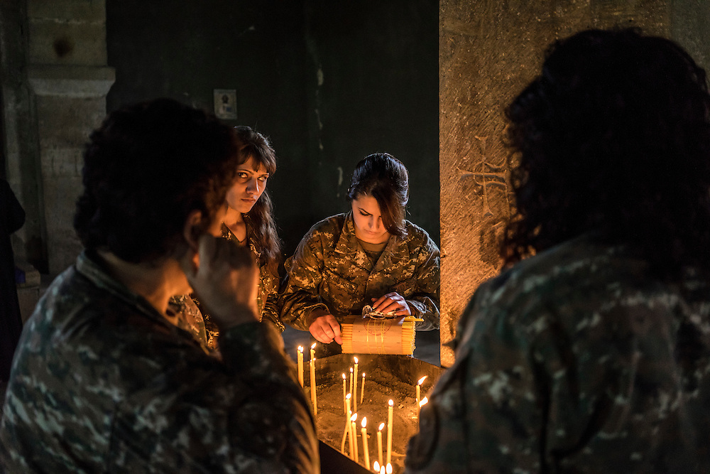 Female fighters with the Nagorno-Karabakh armed forces participate in a service at the Church of Mother Mary on Sunday, May 8, 2016 in Talish, Nagorno-Karabakh. Due to intense nearby fighting in early April, the entire village has been evacuated of civilians.