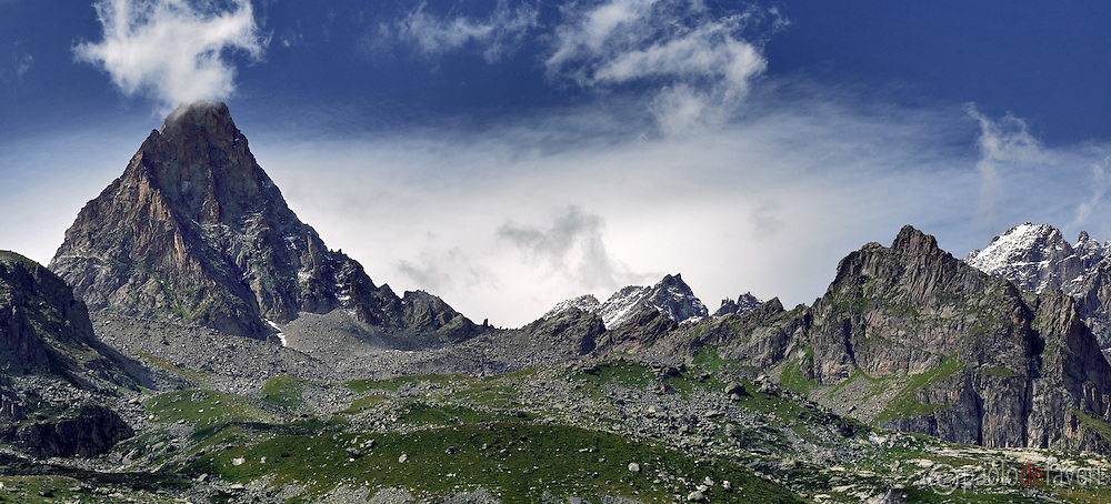 "A view of ""Becco della Tribolazione"" and the surrounding peaks, part of the Gran Paradiso massif in Piedmont, Italy..Maybe it's hard to believe it - since the morning I shot this picture everything was rather peaceful and calm - but that's actually the name given to that mountain by the first men who attempted the first ascension about 150 years ago, probably because of its vertical walls difficult to climb, and also for the weather that here changes every minute.."