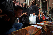 An Egyptian Coptic Christian man breaks down in tears over the caskets of victims October 10, 20011 at the Coptic Hospital in Cairo, Egypt. At least 26 people, mostly Christian,  were killed during sectarian clashes that saw the worst violence since the Revolution that toppled former Egyptian president Hosni Mubarak earlier this year. Egyptian Coptic Christians make up about 10% of Egypt's 80 million population and periodically violence flares between the Christian minority and the majority Muslim population. (Photo by Scott Nelson)