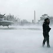 A Secret Service officer holds onto his hat as Marine One heads to Camp David for Pres. Bush to work on his State of the Union speech Sunday, January 23, 2005, in Washington, DC...Photo by Khue Bui