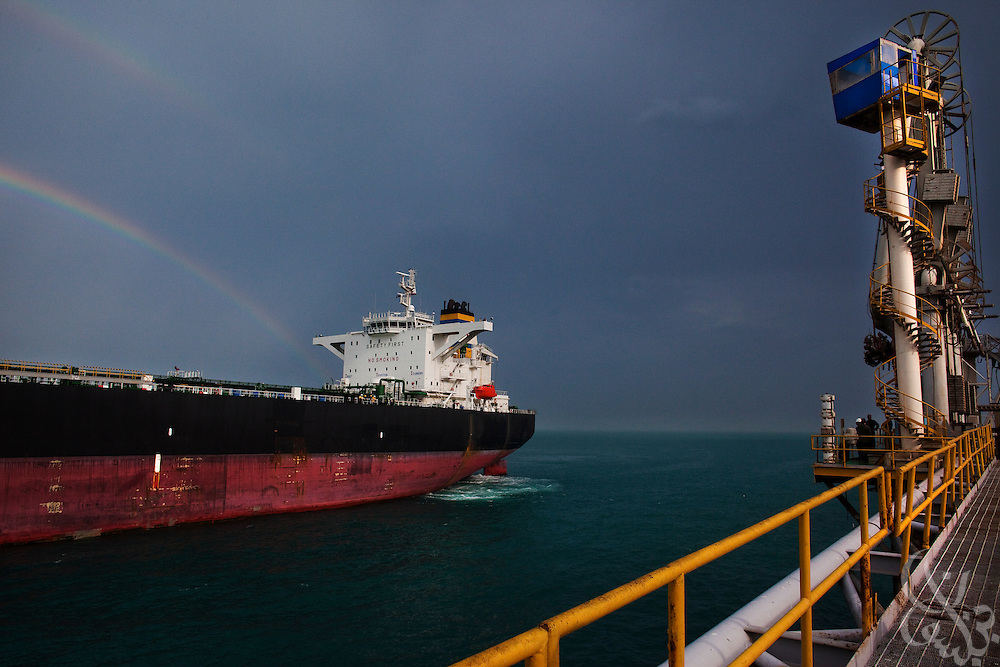 A double rainbow breaks over a Greek tanker arriving at the Al Basrah oil terminal (ABOT) 50 kilometers off the coast of Iraq in the Northern Arabian Gulf February 2, 2010. Iraqi oil exports account for an estimated 75 percent of the country's GDP, and an estimated 85-90 percent of Iraqi oil exports in total come out through this vital terminal originally constructed in the 1970's.