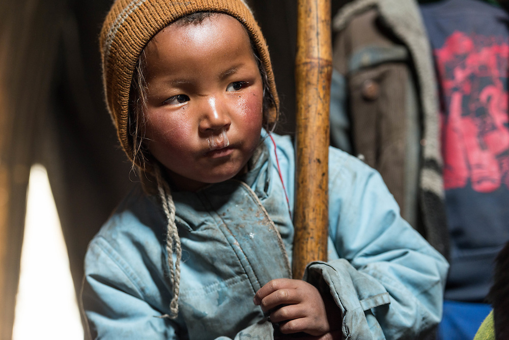 A Tibetan child inside a nomad tent in the camp of Puga on Ladakh's Changtang plateau