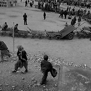 <<coal distribution photo package>>..Afghans line up their carts while waiting for the next truck load of coal to be distributed by the ICRC (International Committe for the Red Cross) inside Kabul city. (shot 2-11-02)