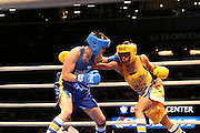 April 1, 2015 - New York, NY. Nisa Rodriguez (blue) competes against Stacia Suttles (gold) during the 88th Annual Daily News Golden Gloves.04/01/2015 Photograph by Maya Dangerfield/NYCity Photo Wire