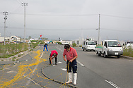 Fishermen mending their nets, in the Matsukawaura district of Soma, Japan, on Monday 23 July 2012.