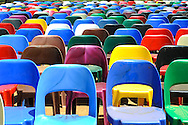 Colourful chairs in the sunshine.