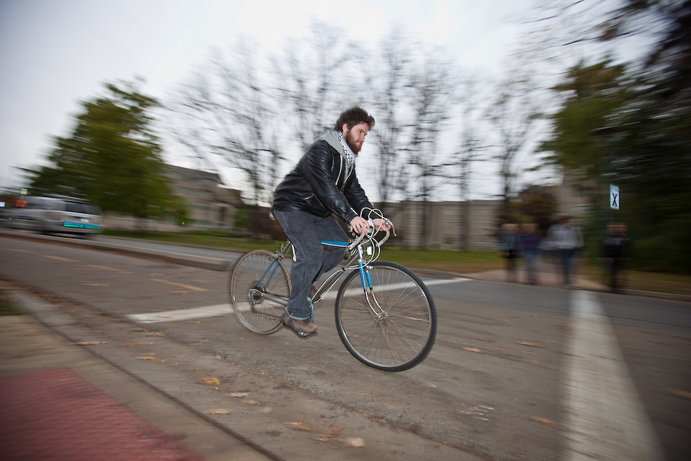 London, Ontario ---11-10-18--- University of Western Ontario graduate student Jonathan Giles cycles through campus October 18, 2011. Giles does not see the need to own a car as he can get to where he needs to go without one.<br /> GEOFF ROBINS The Globe and Mail