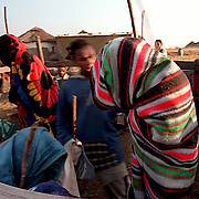 IPMG0369 South Africa, Flagstaff, 1998: Xhosa initiates are covered by blankets as they return to their village from their seclusion having undergone the rite of passage to manhood in tribal Xhosa culture in the former Transkei homeland, near Flagstaff, July 1998...Photograph by Greg Marinovich/South Photographs