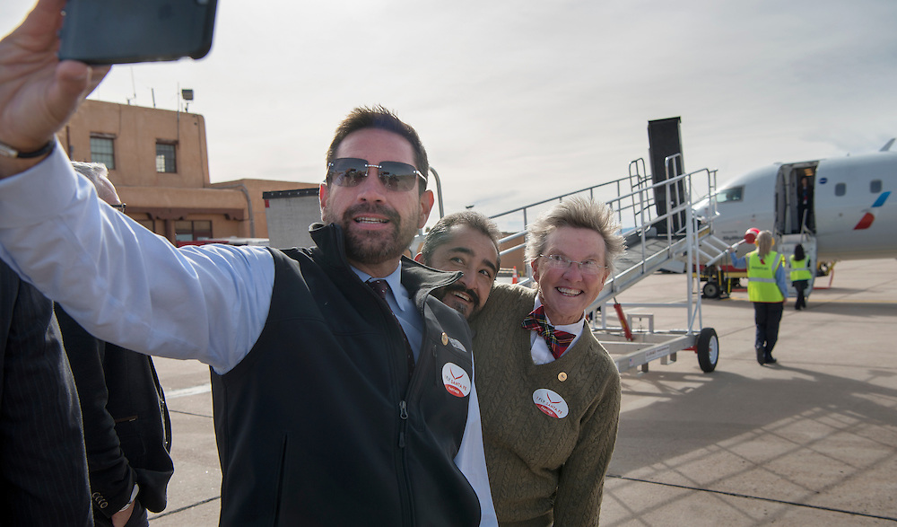em121416c/jnorth/From left, Santa Fe Mayor Javier Gonzales, and City Councilors Ron Trujillo and Signe Lindell take a selfie in front of the first flight from Phoenix at the Santa Fe Municipal Airport, Thursday December 15, 2016. (Eddie Moore/Albuquerque Journal)