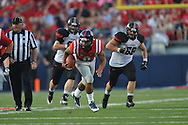 Mississippi quarterback Barry Brunetti (11) is chased by Southeast Missouri State's Jon Slania (68) at Vaught-Hemingway Stadium in Oxford, Miss. on Saturday, September 7, 2013. (AP Photo/Oxford Eagle, Bruce Newman)