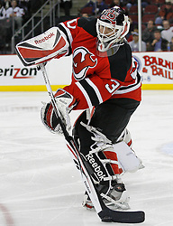 Feb 26, 2009; Newark, NJ, USA; New Jersey Devils goalie Martin Brodeur (30) plays the puck during the third period at the Prudential Center. The Devils defeated the Avalanche 4-0.  and Brodeur recorded a shutout in his return to the Devils.