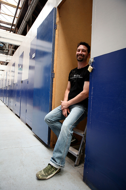 Cedric, 32, company director, in his South West London storage unit. He rents it to store building materials of bathrooms and kitchens for his work. His favourite stored object : a mitre saw.