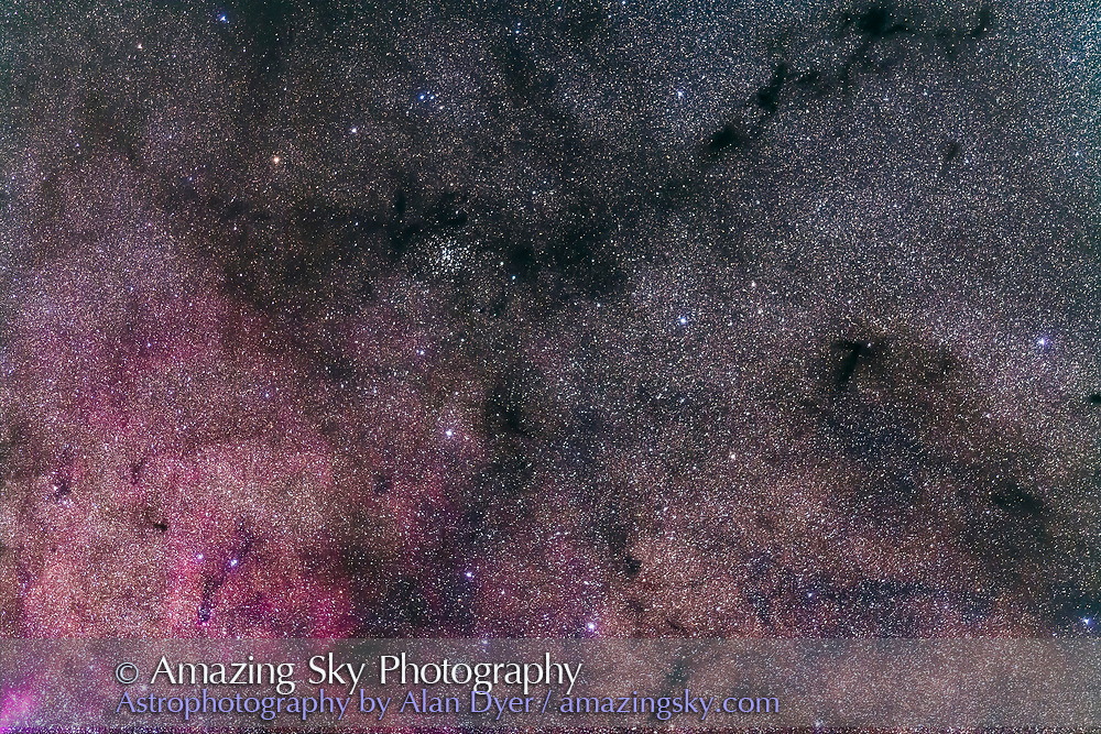 The wonderful open star clusrter NGC 6124 in Scorpius amid a field of dark nebulas and on the edge of a bright star cloud with red emission nebulosity. I call this the Dark River Cluster. <br /> <br /> The small star cluster NGC 6192 is at bottom. Taken with a telephoto lens to simulate a binocular field of view. <br /> <br /> This is a stack of 4 x 2-minute exposures at f/2.8 with the 200mm telephoto lens, and filter-modified Canon 5D MkII at ISO 2500. Tracked on the AP 400 mount.