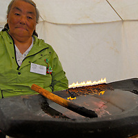Fire made with Arctic cotton and seal fat, The fishing community of Kimmirut. Locally called Quliq