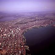 25932-02...WASHINGTON - 1961 aerial photograph of Elliott Bay, downtown Seattle and Lake Washington.