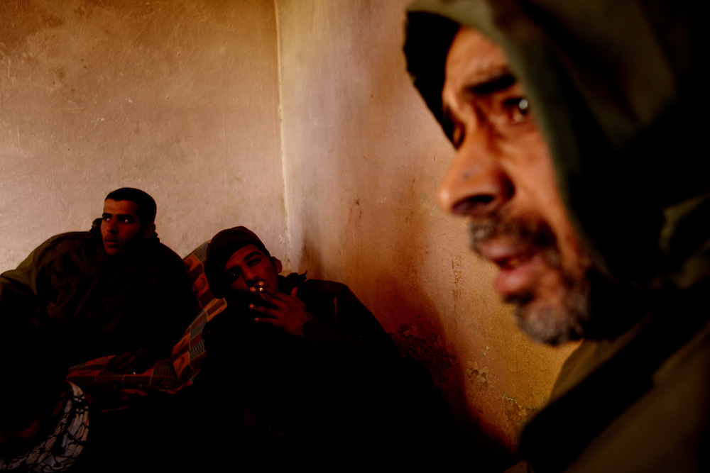 Benghazi, Libya, 01.03.11..Hani El-Hweti, Akram Hussain El-Suaity og Hani Reza Alhawwaz at an army base in Benghazi. The men now loyal to the rebels and working on defensive arms and ..Photo by: Eivind H. Natvig/MOMENT