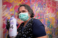 08/09/2015 - Lisbon, Portugal: Aida Alves, 76, with a can during the Lata 65 workshop. Lata 65 was project created by Lara Seixo Rodrigues and is a creative workshop teaching street art to senior citizens. (Eduardo Leal)