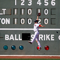 Boston, MA - Boston Red Sox left fielder Daniel Nava leaps for a double hit by Baltimore Orioles batter Manny Machado in the sixth inning at Fenway Park on Saturday, September 22, 2012.   Photo by Matthew Healey
