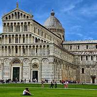 Pisa Cathedral and Leaning Tower of Pisa in Pisa, Italy<br /> The centerpiece of the Piazza del Duomo or Cathedral Square is the medieval Pisa Cathedral.  Construction on Italy&rsquo;s first Pisan Romanesque church began in 1063. The spectacular marble fa&ccedil;ade of the Cathedral of Santa Maria Assunta features blind arcades, arches, columns, three bronze doors and a dome. Wow, it is beautiful!  Did you also notice the iconic leaning bell tower behind it?