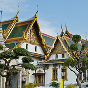 Phra Maha Monthian Group (Paisal Taksin Hall and Hor Phra Dhart Monthian), Snamchand Pavilion (small gray building on left), and topiary garden at the Grand Palace, in Bangkok, Thailand. The Grand Palace (Phra Borom Maha Ratcha Wang) was built on the east bank of the Chao Phraya River starting in 1782, during the reign of Rama I. It served as the official residence of the king of Thailand from the 1700s to mid 1900s.