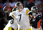 SHOT 1/8/12 3:43:30 PM - Pittsburgh Steelers quarterback Ben Roethlisberger #7 drops back to pass as the Denver Broncos Von Miller #58 closes in during their AFC Wildcard game at Sports Authority Field at Mile High on Sunday January 8, 2012. The Broncos won the game in overtime 29-23. (Photo by Marc Piscotty / © 2012)