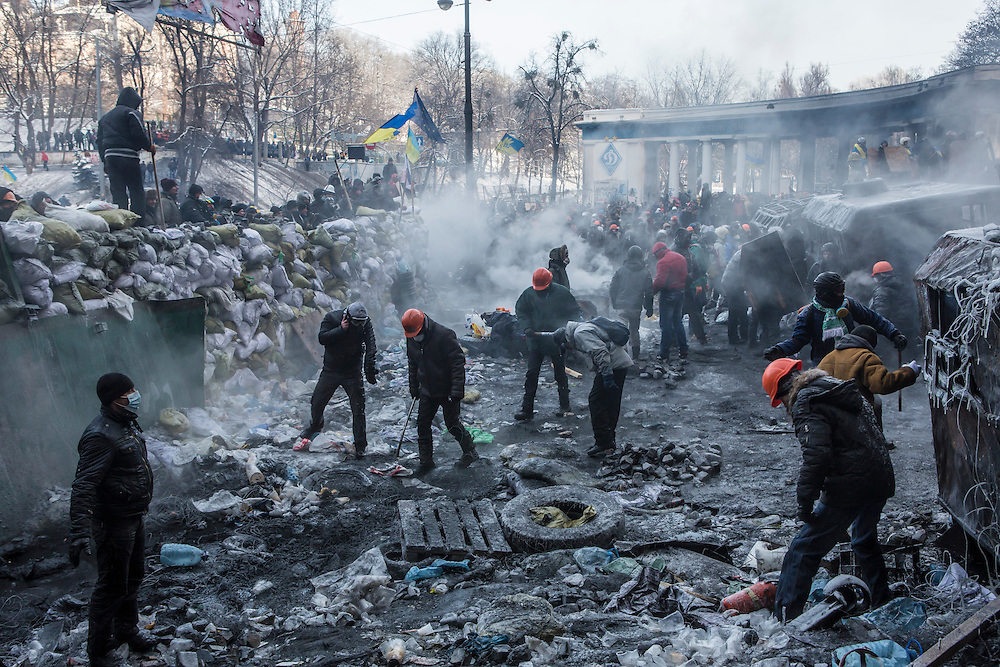 KIEV, UKRAINE - JANUARY 25: Anti-government protesters burn tires and throw rocks during clashes with police on Hrushevskoho Street near Dynamo stadium on January 25, 2014 in Kiev, Ukraine. After two months of primarily peaceful anti-government protests in the city center, new laws meant to end the protest movement have sparked violent clashes in recent days. (Photo by Brendan Hoffman/Getty Images)