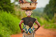 Woman carrying her child and household goods in the Makurdi district of Nigeria.