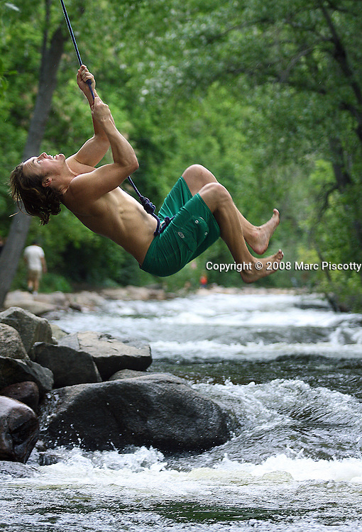 SHOT 7/6/08 12:21:19 PM - Images of Boulder, Co. including tubing and rope swings near Eben G. Fine Park on Boulder Creek. Boulder is the 11th most populous city in the state of Colorado. The United States Census Bureau estimates that in 2005 the population of the city of Boulder was 91,685, the population of the Boulder Metropolitan Statistical Area was 280,440. Boulder is the home of the University of Colorado at Boulder, the largest university in Colorado and Naropa University, the only accredited Buddhist-inspired university in the United States. Boulder is situated 25 miles (40 km) northwest of the Colorado State Capitol of Denver at an elevation of 5,430 feet. Boulder Creek is a popular and at times dangerous place to play and relax in water in Colorado. It is fed by runoff from melting snow in the surrounding mountains..(Photo by Marc Piscotty / © 2008)