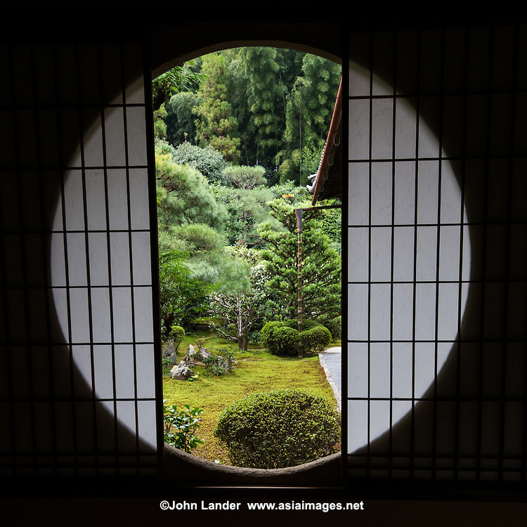 Funda-in was founded in 1321 as a family temple for the Ichijo clan, but always had strong ties with neighboring Tofuku-ji. Funda-in has many interesting details in its interior: dried leaves embedded in the paper shoji screens from different plant leaves. Funda-in also has a very elaborate bamboo tsukubai water basin adorned with ikebana flower arrangements. The temple has three gardens: the South Garden is in front of the main hall and consists of raked gravel with a moss garden at the far end. On the moss lie two groups of stones: the one on the left represents a tortoise, the one on the right a crane. The East Garden is made up of lots of moss, stones and rhododendrons. In its far end is a small pavilion with a round window. The painter and Zen monk Sesshu is said to have designed the southern garden so the temple is also commonly called Sesshu-ji. The modern garden master Shigemori Mirei restored the garden and added the eastern garden.
