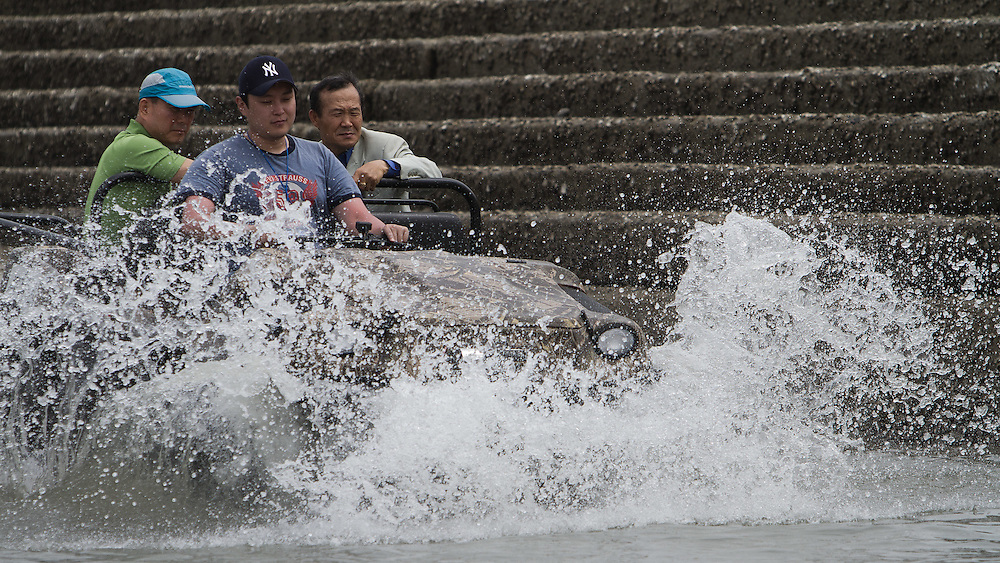 An amphibious vehicle enters the water at the 2011 Korea Match Cup. Gyeonggi Province, Korea. 9 June 2011. Photo: Subzero Images/Korea Match Cup