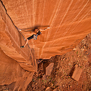 """Pro climber Steph Davis climbing """"Glad To Be A Trad"""" rated 5.13 in Southern Utah."""