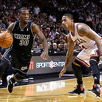 29 January 2012: Miami Heat point guard Norris Cole (30) drives past Chicago Bulls point guard Derrick Rose (1) during the Miami Heat 97-93 victory over the Chicago Bulls at the AmericanAirlines Arena, Miami, Florida, USA.