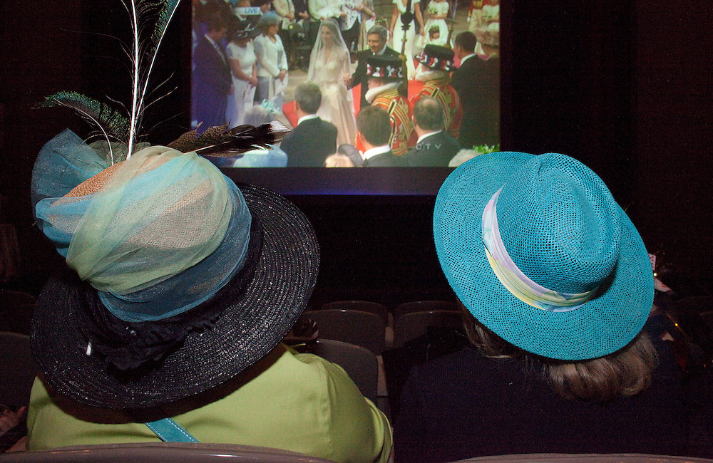 Hundreds of people gathered in their best hats to watch the wedding of Prince William and Catherine Middleton on a big screen at the Palace Theatre in London, Ontario Canada April 29, 2011. <br /> AFP/GEOFF ROBINS/STR