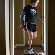 """New treatments have helped Emily Schaller, a 27-year-old cystic fibrosis patient, from Trenton, MI, recently run a half marathon. She prepares to go running on Tuesday, April 21, 2009. She also wears her """"smart vest,"""" which shakes her chest to help break up mucous in her lungs and inhales from her nebulizer. She wears the vest for 25 minutes at least once every day. She inhales Pulmozyme for 7 minutes once and inhales hyper-tonic saline (salt water) twice every day."""