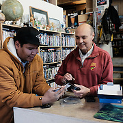 Chad Henry (left) and Richard Lajeunesse discussing how they might hook up a consumer market 4G LTE modem to the existing tower at the Ochiichagwe'Babigo'Ining Ojibway Nation (also known as the Dalles First Nation) in Ontario, Canada as a temporary measure to help alleviate network congestion caused by damaged equipment on the tower. Kenora, Ontario, 13 December 2016.