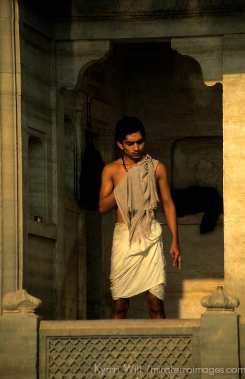 Asia, India, Varanasi. Indian man at ghats.