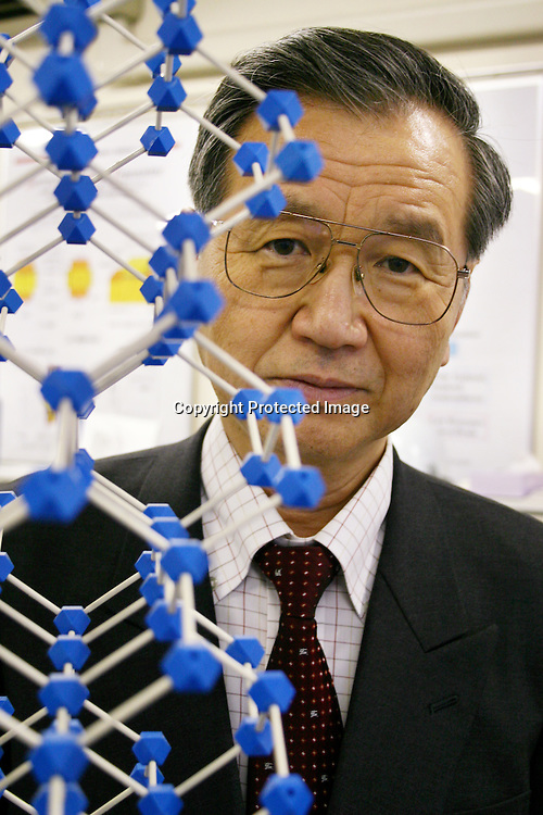 This is Professor Fujio Masuoka, the inventor of flash memory at Tohoku University in Sendai, Japan. He is seen here in with a model of a silicon atom, in the Solid State Laboratory of Tohoku University's Katahira campus in Sendai City, Japan. Masuoka first invented flash memory technology in 1980 when working for Toshiba. At the time he and his company filed five patents but it was not until 1984 that he unveiled his findings at the IDEM Conference in San Francisco. Masuoka continued to work for Toshiba until Sept. 1994, then he joined the faculty of Tohoku University in October '94 as a professor for the school's Research Institute of Electrical Communication. He has been there ever since. Today, flash memory is one of the most widely used technology for digital cameras, mobile phones, iPods, and other consumer electronic devices. To this day, Toshiba still holds the patents to flash memory. Photo taken March 18, 2006.