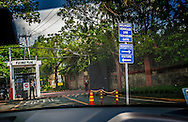 No one, without clearance, is allowed to enter the upscale Forbes Park district, designed to sequester Manila's rich and powerful from the chaotic world outside their tranquil hamlet.  Walls separate the wealthy families from the rest of Philippine society.  Forbes Park, Manila, Philippines.<br /> <br /> Colorful, loudmouthed Rodrigo Duterte was elected president of the Philippines on the 9th of May 2016.  He has inherited a country with a massive gulf between rich and poor.  Despite a 5.8% GDP growth rate in 2015, the slums of Manila and Cebu remain massive repositories for a permanent impoverished underclass.<br /> <br /> The Atlantic Magazine wrote in, &quot;in 2012, Forbes Asia announced that the collective wealth of the 40 richest Filipino families grew US$13 billion during the 2010-2011 year, to US$47.4 billion--an increase of 37.9%&quot;, compared with 3.7% and 2.8% in Malaysia and Japan respectively over the same period.<br /> <br /> On the other hand, 32% of children suffered from moderate to severe growth stunting due to malnutrition, 60% of Filipinos will die without seeing a healthcare professional and 26.5% of Filipinos live on less than US$1/day.