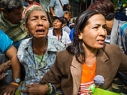 03 SEPTEMBER 2016 - BANGKOK, THAILAND:  Residents of the Pom Mahakan community cry when Bangkok city officials storm into the community to start evictions. Hundreds of people from the Pom Mahakan community and other communities in Bangkok barricaded themselves in the Pom Mahakan Fort to prevent Bangkok officials from tearing down the homes in the community Saturday. The city had issued eviction notices and said they would reclaim the land in the historic fort from the community. People prevented the city workers from getting into the fort. After negotiations with community leaders, Bangkok officials were allowed to tear down 12 homes that had either been abandoned or whose owners had agreed to move. The remaining 44 families who live in the fort have vowed to stay.     PHOTO BY JACK KURTZ