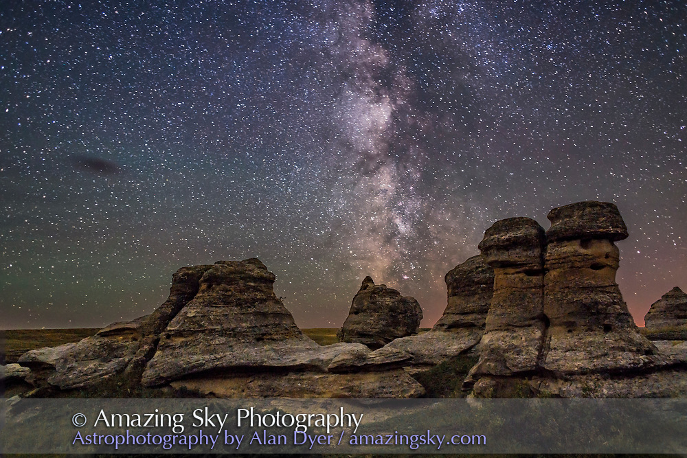 The Milky Way over the sandstone hoodoos of Writing-on-Stone Provincial Park in southern Alberta. <br /><br />This is a comppsite of a single 30-second untracked exposure for the sky with the Canon 6D at ISO 4000, and 24mm lens at f/2, as the final frame of a 300-frame time-lapse, with a 6.5-minute exposure for the ground, taken at the end of the time-lapse with the lens stopped down to f/4 and the Canon at ISO 1600 for lower noise and better depth of field. <br /><br />This final frame of the star trail time-lapse at Writing-on-Stone is made to crossfade to from the movie. Two versions of the ground are in the layered PSD file for demo purposes &mdash; 1) from a stack of the last 10 frames and 2) from a single 6.5 minute exposure with an LENR dark frame but the camera shifted a little so that image had to be manually aligned.