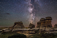 The Milky Way over the sandstone hoodoos of Writing-on-Stone Provincial Park in southern Alberta. <br /> <br /> This is a comppsite of a single 30-second untracked exposure for the sky with the Canon 6D at ISO 4000, and 24mm lens at f/2, as the final frame of a 300-frame time-lapse, with a 6.5-minute exposure for the ground, taken at the end of the time-lapse with the lens stopped down to f/4 and the Canon at ISO 1600 for lower noise and better depth of field. <br /> <br /> This final frame of the star trail time-lapse at Writing-on-Stone is made to crossfade to from the movie. Two versions of the ground are in the layered PSD file for demo purposes &mdash; 1) from a stack of the last 10 frames and 2) from a single 6.5 minute exposure with an LENR dark frame but the camera shifted a little so that image had to be manually aligned.