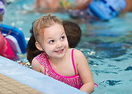 Middletown, New York - A young girl smiles during swimming lessons at the YMCA of Middletown on Nov. 4, 2014.