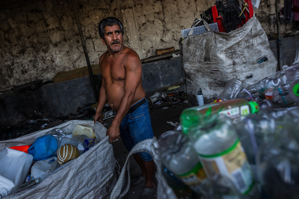 SAN SALVADOR, EL SALVADOR - MAY 25, 2015: Rigoberto Ruiz, 54, organizes recyclables that he collects and sells for a living. The government argues that the gang crackdown is just part of a broader strategy to invest in education and job creation in the most violent communities, rehabilitate gang members, and strengthen the rule of law.  The strategy's road map is an ambitious $2.1 billion plan developed with the help of the private sector, churches and aid groups.  But El Salvador's limping economy cannot create the jobs that are needed to provide an alternative to the gangs.  Growth has hovered around 2 percent for years. Remittances from Salvadorans working in the United States account for about 17 percent of national income and half the workforce toils in the informal economy.  PHOTO: Meridith Kohut for The New York Times