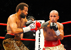 Nov 8, 2008; New York, NY, USA; Francisco Figueroa (Tan/Red) and Emanuel Augustus (Leopard) trade punches during their fight at Madison Square Garden in New York, NY.