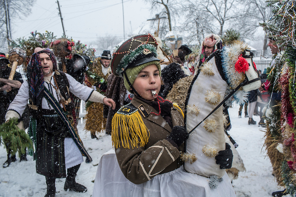 Petrya Velia, 11, and other revelers in costume celebrate the Malanka Festival on Thursday, January 14, 2016 in Krasnoilsk, Ukraine. The annual celebrations, which consist of costumed villagers going in a group from house to house singing, playing music, and performing skits, began the previous sundown, went all night, and will last until evening.