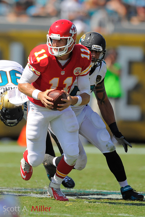 Kansas City Chiefs quarterback Alex Smith (11) runs upfield during the Chiefs 28-2 win over the Jacksonville Jaguars at EverBank Field on Sept. 8, 2013 in Jacksonville, Florida. The <br /> <br /> &copy;2013 Scott A. Miller