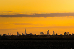London's skyline captured from Hainult in Essex as the sun sets.  // Contact: paul@pauldaveycreative.co.uk Mobile 07966 016 296