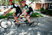mkb080916d/metro/Marla Brose/080916<br /> Near a tree tied with multiple orange ribbons, Nathan Barkocy, 17, right, rides with coach Stephen Williamson, while heading out on a short ride together with Adam Brugge, Tuesday, August 9, 2016. Both Brugge and Williamson were riding with Barkocy when he was hit by a car and thrown from his bike during a training ride last January. Barkocy, who was in a coma for almost two week, has recovered and is getting ready to head back to school. He hasn't been cleared to ride a bike on his own, but he can ride a tandem bike. (Marla Brose/Albuquerque Journal)